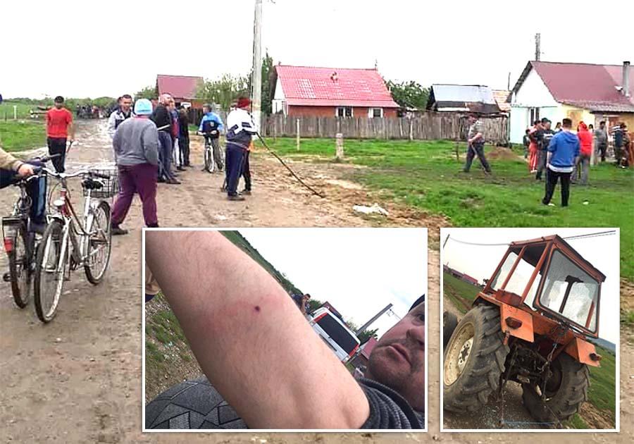 CARE PE CARE. În încăierarea provocată de romii prinşi la furat, rudele şi vecinii lor din colonie au ripostat cu bâte şi cu pietre, doi localnici fiind răniţi, iar tractorul unuia dintre ei, avariat (foto: alesdonline.ro)